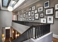Wall-next-to-the-staircase-is-a-popular-spot-for-the-display-of-photographs